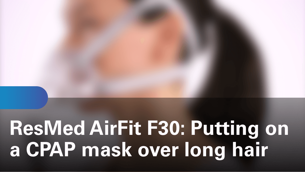 sleep-apnea-airfit-f30-putting-on-a-cpap-mask-over-long-hair