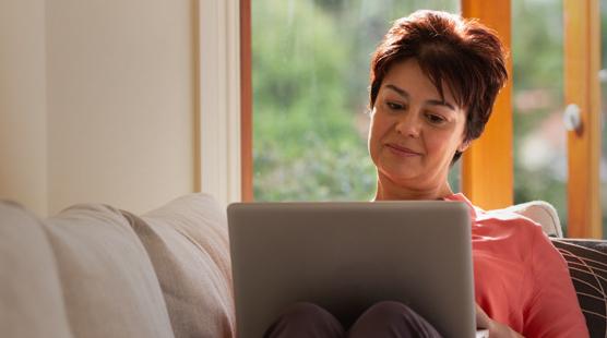 sleep-apnea-global-woman-on-couch-with-laptop