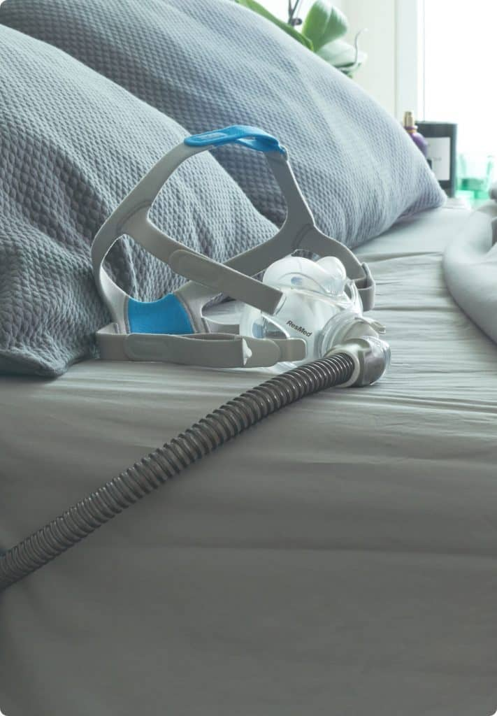 sleep-apnea-sleepapnea-cpap-mask-on-bed-v2